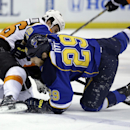 St. Louis Blues' Steve Ott, right, gets tangled up with Philadelphia Flyers' Zac Rinaldo during the second period of an NHL hockey game Tuesday, April 1, 2014, in St. Louis The Associated Press