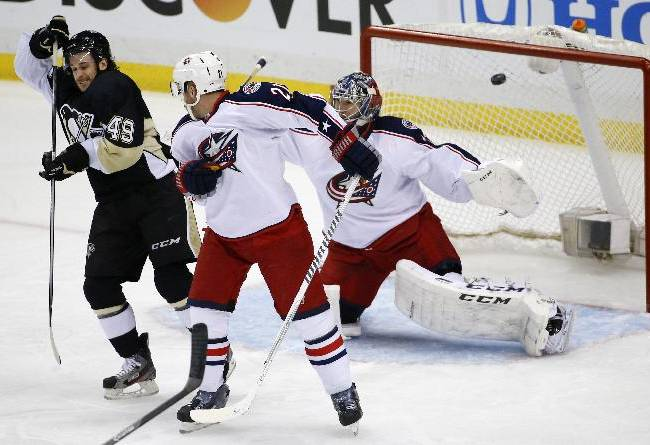 Pittsburgh Penguins' Brian Gibbons (49) deflects a shot over Columbus Blue Jackets goalie Sergei Bobrovsky (72) for a goal in the first period of a first-round NHL playoff hockey game in Pittsburgh on Saturday, April 19, 2014