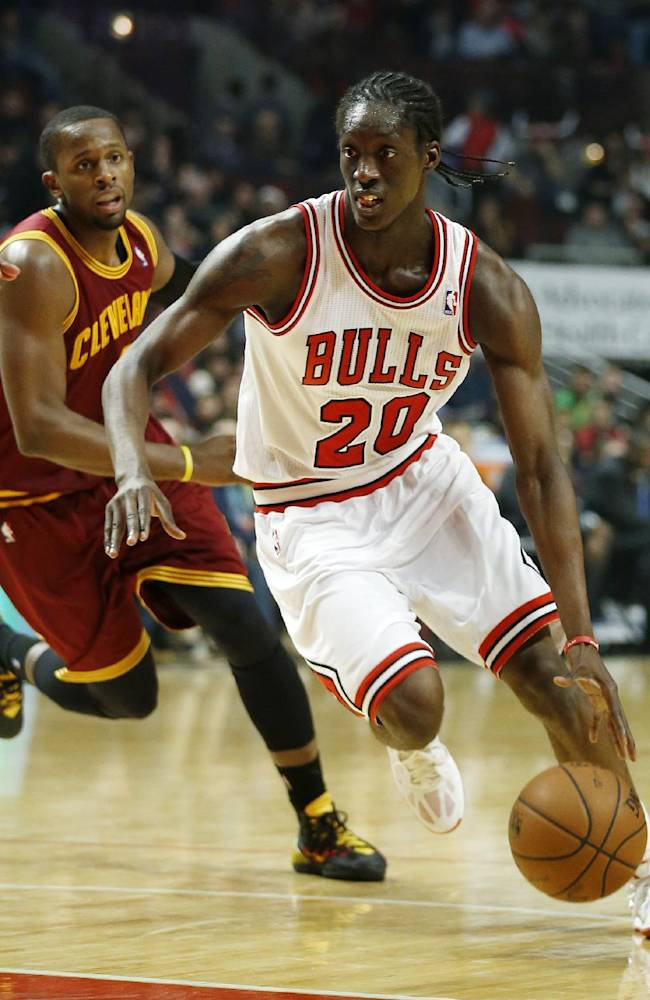 Chicago Bulls forward Tony Snell (20) advances with Cleveland Cavaliers guard C.J. Miles (0) trailing during the second half of an NBA basketball game on Saturday, Dec. 21, 2013, in Chicago