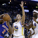 New York Knicks' Raymond Felton, left, looks to pass away from Golden State Warriors' Stephen Curry (30) and Jermaine O'Neal, right, during the second half of an NBA basketball game Sunday, March 30, 2014, in Oakland, Calif The Associated Press