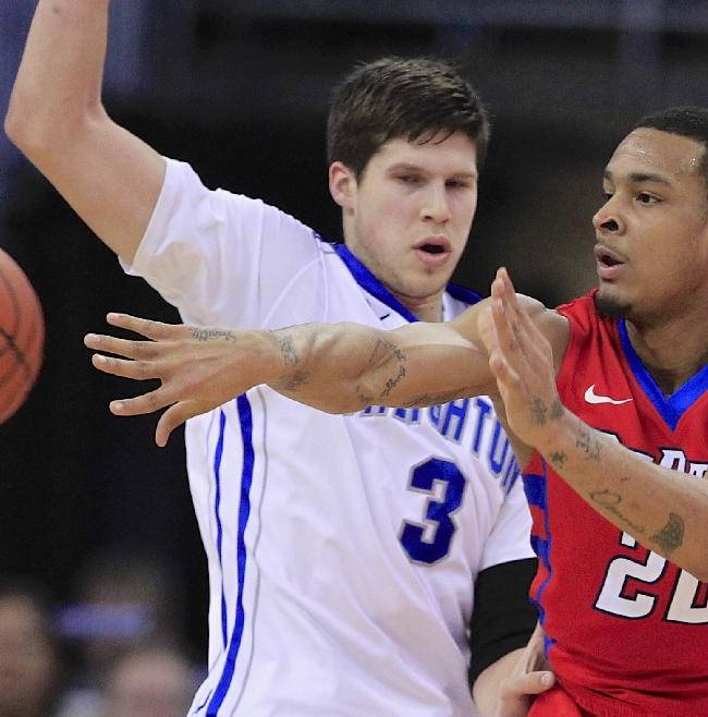 DePaul's Brandon Young (20) passes the ball in front of Creighton's Doug McDermott (3) in the first half of an NCAA college basketball game in Omaha, Neb., Friday, Feb. 7, 2014