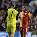 Galatasaray's Didier Drogba, right, goes to shake hands with Chelsea goalkeeper Petr Cech following the end of the Champions League last 16 second leg soccer match between Chelsea and Galatasaray at Stamford Bridge stadium in London, Tuesday, March 18, 20