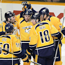 Nashville Predators center Mike Fisher, left, celebrates with his teammate after scoring a goal in the second period of an NHL hockey game against the Boston Bruins Tuesday, Dec. 16, 2014, in Nashville, Tenn The Associated Press
