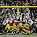 Washington Redskins kicker Kai Forbath (2) boots a field goal during the second half of an NFL football game against the Philadelphia Eagles in Landover, Md., Saturday, Dec. 20, 2014, to give the Redskins a 27-24 victory over the Eagles. (AP Photo/Mark Tenally)