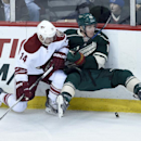 Arizona Coyotes center Joe Vitale (14) checks Minnesota Wild center Ryan Carter (18) during the first period of an NHL hockey game Saturday, Jan. 17, 2015, in St. Paul, Minn The Associated Press