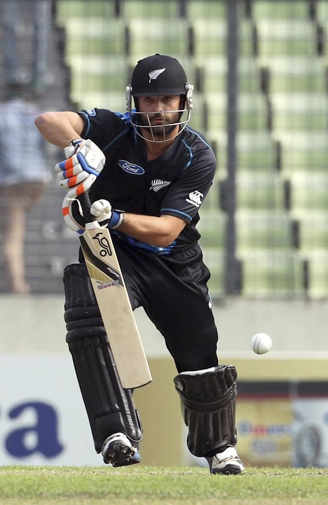 New Zealand's Anton Devcich plays a shot during the Twenty20 international cricket match against Bangladesh in Dhaka, Bangladesh, Wednesday, Nov. 6, 2013