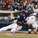 San Diego Padres' Everth Cabrera is out at home as San Francisco Giants catcher Buster Posey tags him in the fifth inning of a baseball game Saturday, April 19, 2014, in San Diego. Cabrera was trying to score from third on an infield grounder The Associat