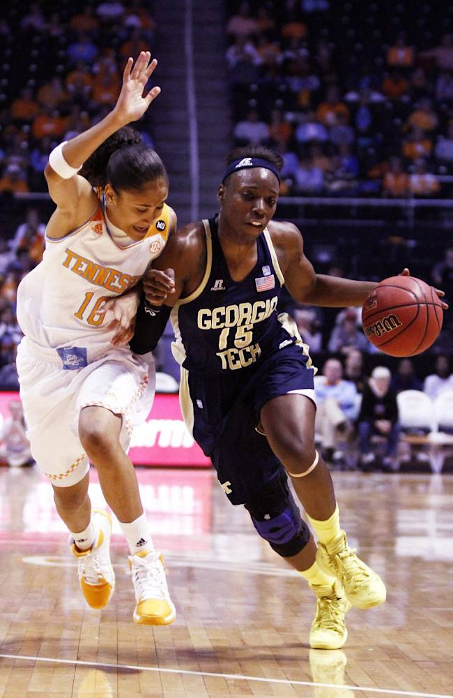 Georgia Tech guard Tyaunna Marshall (15) drives against Tennessee guard Meighan Simmons (10) in the first half of an NCAA college basketball game on Sunday, Nov. 17, 2013, in Knoxville, Tenn