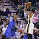 Utah Jazz's Trey Burke (3) shoots as Dallas Mavericks' Vince Carter (25) defends in the first quarter during an NBA basketball game Wednesday, March 12, 2014, in Salt Lake City. (AP Photo/Rick Bowmer)