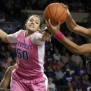 Kentucky's Azia Bishop, left, and South Carolina's Ashley Bruner go after a rebound during the first half of an NCAA college basketball game at Memorial Coliseum in Lexington, Ky., Thursday, Feb. 14, 2013. (AP Photo/James Crisp)
