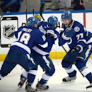 Tampa Bay Lightning center Tyler Johnson (9) celebrates with left wing Ondrej Palat (18), of the Czech Republic, and defenseman Victor Hedman (77) after scoring the winning goal at the end of the third period of Game 3 of a second-round NHL Stanley Cup hockey playoff series in Tampa, Fla., Wednesday, May 6, 2015. The Lightning won 2-1.(AP Photo/Phelan M. Ebenhack)