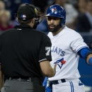 Toronto Blue Jays designated hitter Jose Bautista, right, questions home plate umpire Jim Reynolds on a call during the third inning of a baseball game, Thursday, May 21, 2015 in Toronto. (Nathan Denette/The Canadian Press via AP) MANDATORY CREDIT