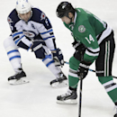 Dallas Stars left wing Jamie Benn (14) skates with the puck against Winnipeg Jets defenseman Mark Stuart (5) during the third period of an NHL hockey game Monday, March 24, 2014, in Dallas. The Stars won 2-1 The Associated Press