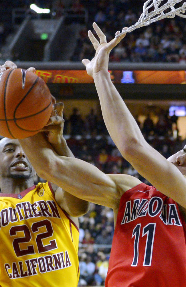 Arizona forward Aaron Gordon, right, grabs a rebound away from Southern California guard Byron Wesley during the second half of an NCAA college basketball game, Sunday, Jan. 12, 2014, in Los Angeles