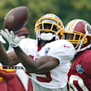 Washington Redskins receiver Aldrick Robinson catches a pass in front of cornerback E.J. Biggers during practice at the team's NFL football training facility, Sunday, July 27, 2014 in Roanoke, Va The Associated Press