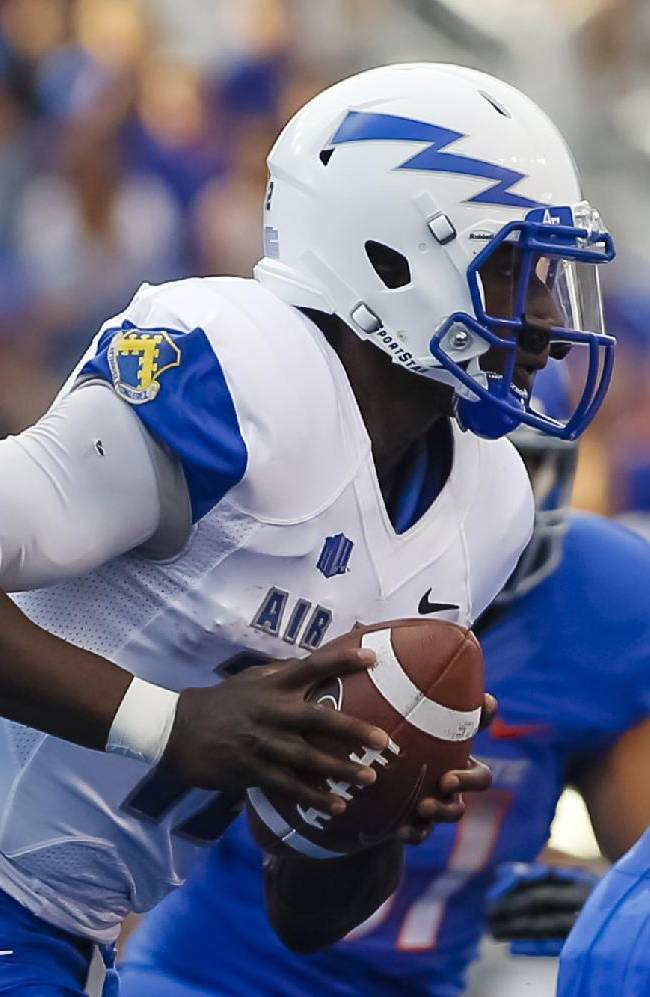 Air Force quarterback Jaleel Awini (12) moves with the ball during the first half of an NCAA college football game against Boise State in Boise, Idaho, Friday, Sept. 13, 2013