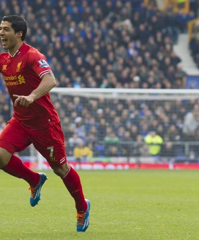 Liverpool's Luis Suarez celebrates after scoring against Everton during their English Premier League soccer match at Goodison Park Stadium, Liverpool, England, Saturday, Nov. 23, 2013