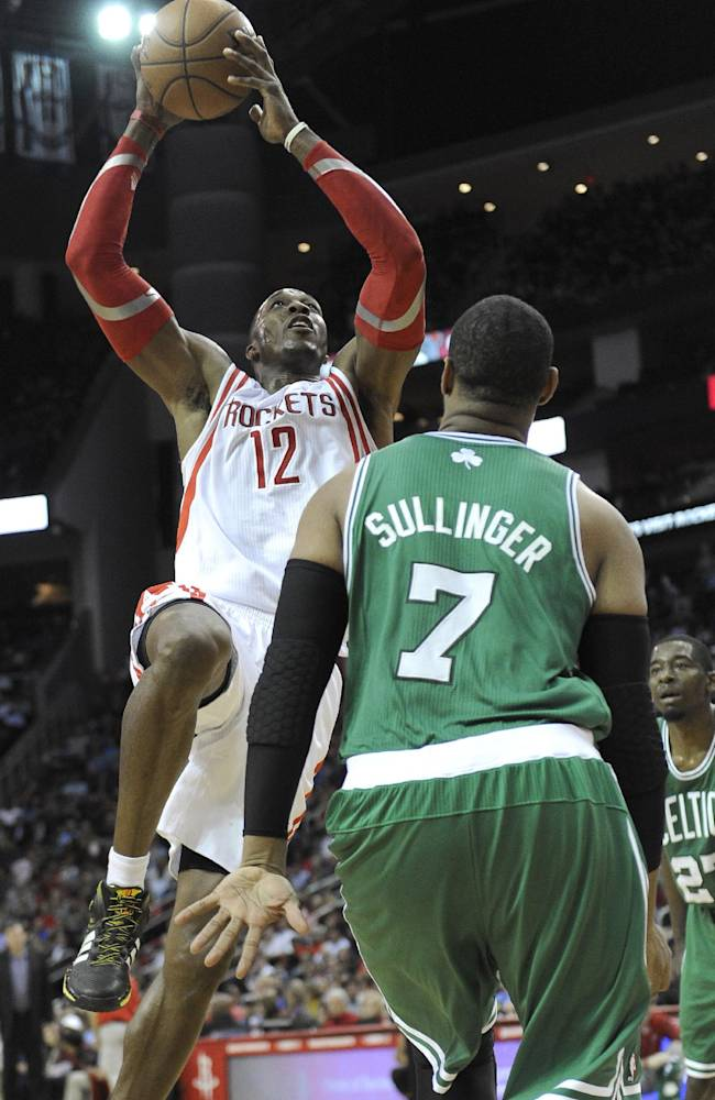 Houston Rockets' Dwight Howard (12) shoots over Boston Celtics' Jared Sullinger (7) in the second half of an NBA basketball game Tuesday, Nov. 19, 2013, in Houston. The Rockets won 109-85