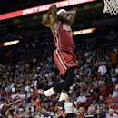 Miami Heat's LeBron James goes up to dunk in the first half of an NBA basketball game against the Sacramento Kings, Friday, Dec. 20, 2013, in Miami. (AP Photo/Lynne Sladky)