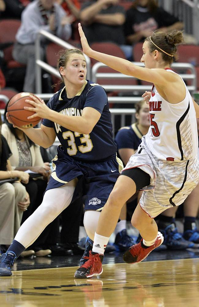 Quinnipiac's Gillian Abshire, left, looks for help from the defensive pressure of Louisville's Megan Deines during the second half of an NCAA college basketball game, Monday, Nov. 11, 2013, in Louisville, Ky. Louisville defeated Quinnipiac 100-82