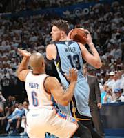 OKLAHOMA CITY, OK - APRIL 29: Mike MIller #13 of the Memphis Grizzlies looks to pass the ball against the Oklahoma City Thunder. In Game Five of the Western Conference Quarterfinals of the NBA Playoffs at Chesapeake Energy Arena on April 29, 2014 in Oklahoma City, Oklahoma. (Photo by Layne Murdoch/NBAE via Getty Images)