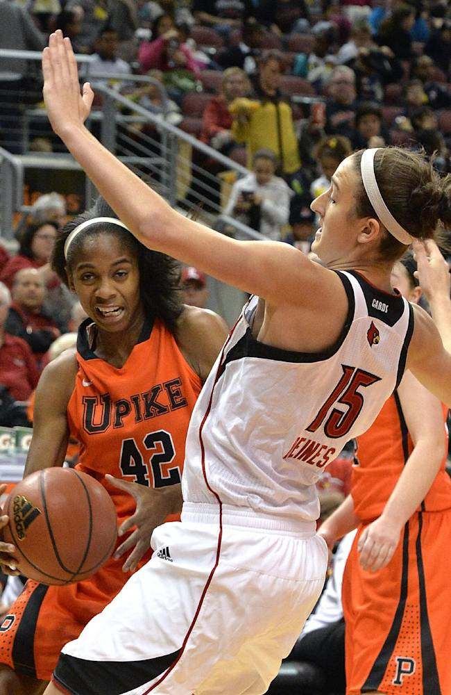 Louisville's Megan Deines, right, takes a charge from Pikeville's Callisha Johnson during the first half of an NCAA college exhibition game, Tuesday, Nov. 5, 2013, in Louisville, Ky. Louisville defeated Pikeville 127-40