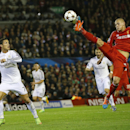 Liverpool's Martin Skrtel, right, intercepts a pass intended for Real Madrid's Cristiano Ronaldo during the Champions League group B soccer match between Liverpool and Real Madrid at Anfield Stadium, Liverpool, England, Wednesday Oct. 22, 2014