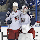 Columbus Blue Jackets goalie Sergei Bobrovsky (72), of Russia, celebrates with defenseman Tim Erixon (20) after the Blue Jackets defeated the Tampa Bay Lightning 3-1 during an NHL hockey game Saturday, Dec. 6, 2014, in Tampa, Fla The Associated Press