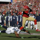 San Francisco 49ers quarterback Colin Kaepernick, right, runs with the ball before being brought down by Seattle Seahawks middle linebacker Bobby Wagner, left, in the first half of an NFL football game, Sunday, Dec. 8, 2013, in San Francisco The Associate