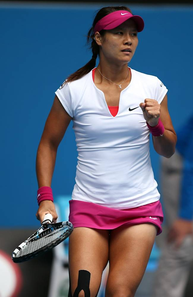 Li Na of China celebrates a point won against Ekaterina Makarova of Russia during their fourth round match at the Australian Open tennis championship in Melbourne, Australia, Sunday, Jan. 19, 2014