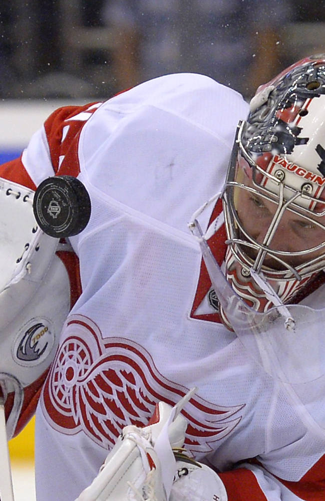 Detroit Red Wings goalie Jimmy Howard stops a shot during the second period of an NHL hockey game against the Los Angeles Kings, Saturday, Jan. 11, 2014, in Los Angeles