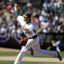 Oakland Athletics' Jim Johnson works against the Seattle Mariners in the ninth inning of a baseball game Sunday, April 6, 2014, in Oakland, Calif. (AP Photo/Ben Margot)