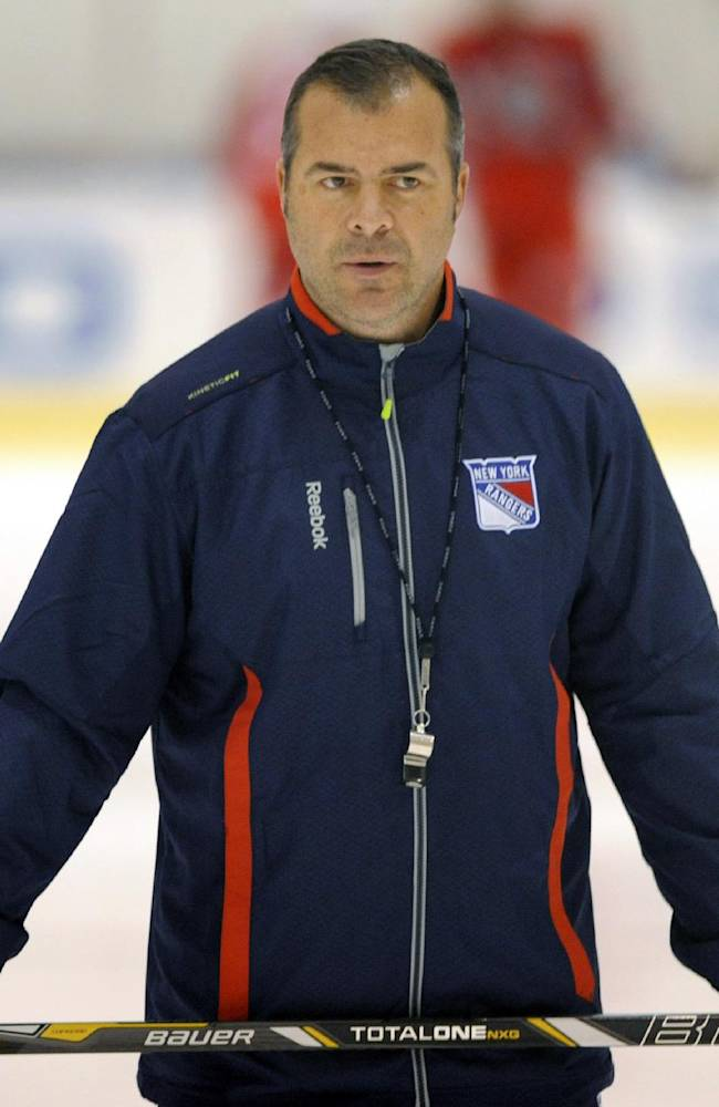 New York Rangers coach Alain Vigneault watches his team during NHL hockey training camp Friday, Sept. 13, 2013, in Greenburgh N.Y