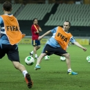 Spain's Andres Iniesta, center, Roberto Soldado, left, vie for the ball as Spain head coach Vicente Del Bosque, right, looks on during a Confederations Cup soccer training at Castelao stadium in Fortaleza, Brazil, Saturday, June 22, 2013. (AP Photo/Victor R. Caivano)
