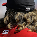The long hair of Washington Nationals' Jayson Werth sticks out of his hat as he takes the field in the fifth inning of an exhibition spring training baseball game against the New York Yankees, Tuesday, March 11, 2014, in Viera, Fla The Associated Press