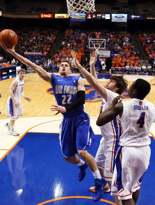 Air Force's Max Yon (22) goes for a layup against Boise State's Nick Duncan, second from right, and Thomas Bropleh (4) during the first half of an NCAA college basketball game in Boise, Idaho, on Wednesday, Jan. 29, 2014. Boise State won 69-58
