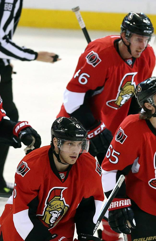 Ottawa Senators Erik Karlsson (65) looks up at the clock as he skates off with line mates Bobby Ryan (6), Kyle Turris (7),  Patrick Wiercioch (46) and Clarke MacArthur(16)  during the third period of an NHL hockey game against the Los Angeles Kings in Ottawa, Saturday, Dec. 14, 2013