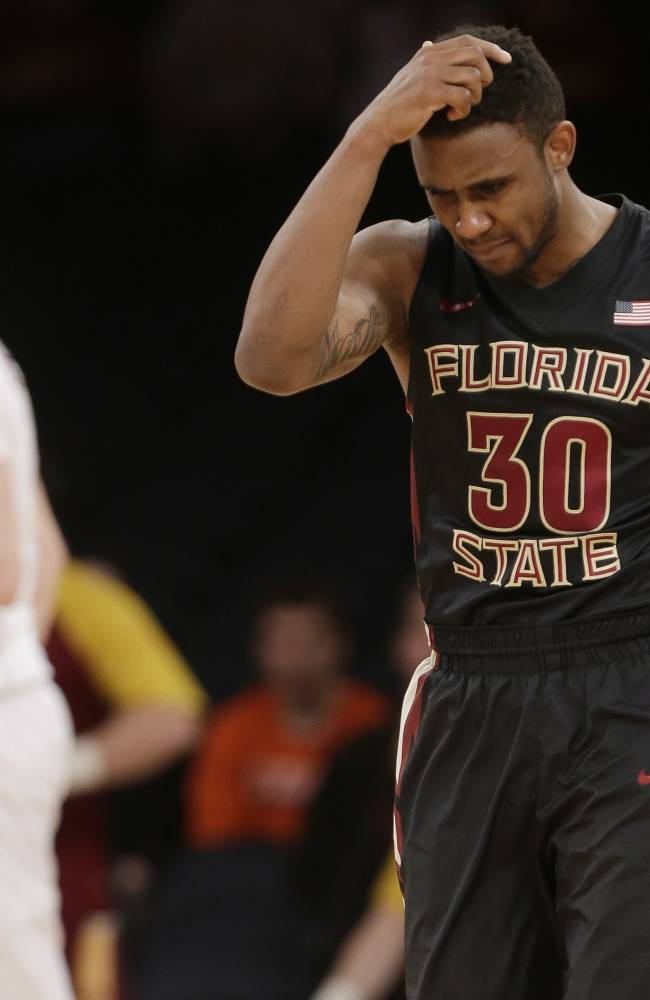 Florida State's Ian Miller (30) reacts to a call during overtime of an NCAA college basketball game against Minnesota in the semifinals of the NIT, early Wednesday, April 2, 2014, in New York. Minnesota won 67-64
