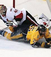 Nashville Predators forward Viktor Stalberg (25), of Sweden, collides with Ottawa Senators goalie Craig Anderson (41) in the first period of an NHL hockey game Saturday, Jan. 11, 2014, in Nashville, Tenn. Stalberg was tripped on the play and awarded a penalty shot. (AP Photo/Mark Humphrey)