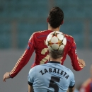CSKA's Georgi Milanov is challenged by Manchester City's Pablo Zabaleta during the Champions League Group E soccer match between CSKA Moscow and Manchester City at Arena Khimki stadium in Moscow, Russia, Tuesday Oct. 21, 2014