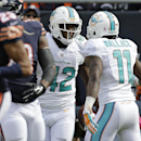 Miami Dolphins tight end Charles Clay (42) celebrates his touchdown reception with wide receiver Mike Wallace (11) during the first half of an NFL football game against the Chicago Bears Sunday, Oct. 19, 2014 in Chicago The Associated Press