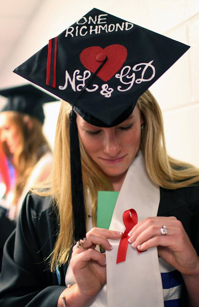 Laura Jordan wears a red ribbon with her hat decorated with initials of Natalie Lewis and Ginny Doyle before the University of Richmond's Commencement Ceremony in Richmond, Va. on Sunday, May 11, 2014. Lewis, the director of basketball operations of the University of Richmond women's basketball team, and Doyle, the team's associate head coach, died in Friday night's hot air balloon crash in Caroline County. (AP Photo/Richmond Times-Dispatch, Daniel Sangjib Min)