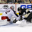 Pittsburgh Penguins' Brandon Sutter (16) can't get a shot past Columbus Blue Jackets goalie Sergei Bobrovsky (72) during the second period of a first-round NHL playoff hockey game in Pittsburgh on Wednesday, April 16, 2014 The Associated Press