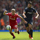 Liverpool's Jordan Henderson, left, fights for the ball against Southampton's Graziano Pelle during their English Premier League soccer match at Anfield Stadium, Liverpool, England, Sunday Aug. 17, 2014