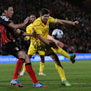 Liverpool's Steven Gerrard, right, and Bournemouth's Tommy Elphick tussle for the ball during the English League Cup soccer quarterfinal match between AFC Bournemouth and Liverpool at Goldsands Stadium, Bournemouth, England, Wednesday, Dec. 17, 2014