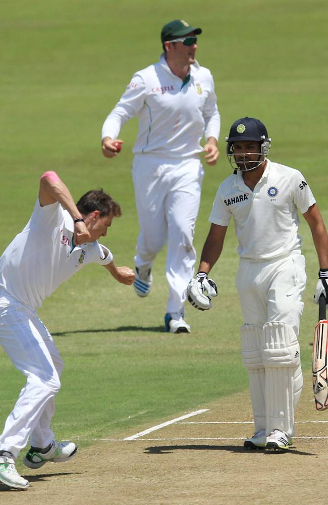 South Africa's bowler Dale Steyn, left, celebrates after India's batsman Rohit Sharma, right, for a duck as captain Graeme Smith, center, reacts during second day of their cricket test match at Kingsmead stadium, Durban, South Africa, Friday, Dec. 27, 2013