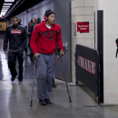 In this photo taken on Friday, Nov. 22, 2013, Chicago Bulls point guard Derrick Rose (1) leaves the Moda Center on crutches after he was injured in an NBA basketball game against the Portland Trail Blazers in Portland, Ore. (AP Photo/The Oregonian, Bruce Ely )