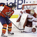 Phoenix Coyotes goalie Mike Smith blocks a shot from Florida Panthers right wing Scottie Upshall during the first period of an NHL hockey game, Tuesday, March 11, 2014, in Sunrise, Fla The Associated Press