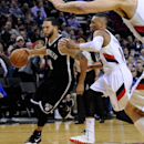 Brooklyn Nets' Deron Williams (8) drives against Portland Trail Blazers' Damian Lillard (0) during the first half of an NBA basketball game in Portland, Ore., Wednesday Feb. 26, 2014 The Associated Press