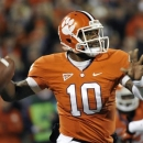 FILE - This Nov. 24, 2012 file photo shows Clemson quarterback Tajh Boyd looking to throw against South Carolina during the first half of an NCAA college football game in Clemson, S.C. Boyd will return to Clemson for his senior season. The junior quarterback announced his intention to hold off on the NFL on Wednesday, Jan. 9, 2013. (AP Photo/Rainier Ehrhardt, File)